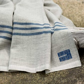 Swans Island Heritage Throw - handwoven in grey corriedale wool with Indigo stripes