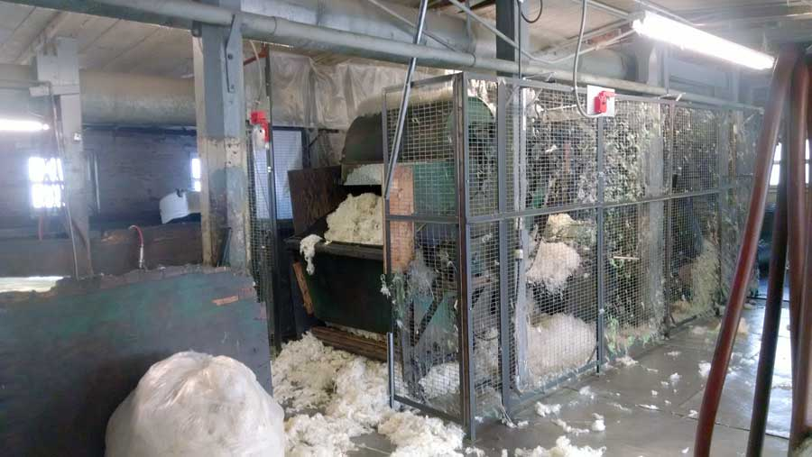 Wool moving through the picker at the fiber mill