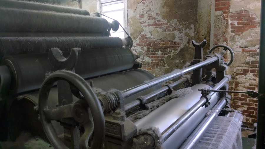 The carder at the fiber mill, processing Swans Island yarn