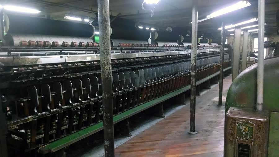 Spinning frames inside the fiber mill, making Swans Island yarn